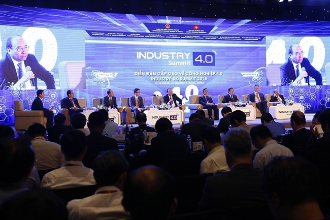 Prime Minister Nguyen Xuan Phuc attended the opening ceremony of the Industry 4.0 Summit and Expo 2018 in Hanoi on July 13. In the photo: The Prime Minister speaks at a policy dialogue themed Vietnamese Policy on Enhancing Access to the Fourth Industrial Revolution. Photo: Duong Giang/VNA