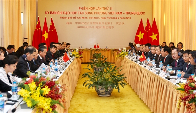 Deputy Prime Minister and Foreign Minister Pham Binh Minh and State Councillor and Foreign Minister of China Wang Yi co-chaired the 11th meeting of the Steering Committee for Vietnam – China Bilateral Cooperation in Ho Chi Minh City on September 16. Photo: Quang Nhut/VNA