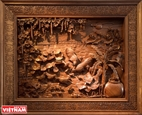 Carved wood pictures show Vietnamese identity