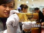 Giá vàng trên thị trường châu Á xuống thấp nhất trong hai tuần gần đây