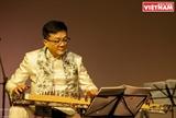Tri Nguyên virtuose de la cithare à 16 cordes