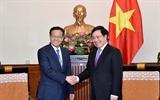 ឧបនាយករដ្ឋមន្ត្រី រដ្ឋមន្ត្រីការបរទេស Pham Binh Minh ទទួលជួបជាមួយប្រធានតំបន់ស្វយ័ត Guangxi Zhuang