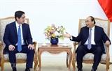 Le PM Nguyen Xuan Phuc reçoit le directeur général du groupe philippin JG