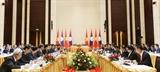 Phó Thủ tướng Trịnh Đình Dũng thăm làm việc tại Lào
