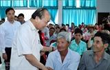 Премьер-министр Вьетнама принял участие в программе Тэт в семейном кругу в провинции Виньлонг