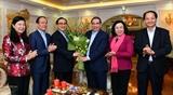 Руководители Ханоя поздравили бывших руководителей Партии и Государства с наступающим Тэтом