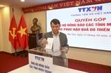 Thông tấn xã Việt Nam quyên góp ủng hộ đồng bào miền Trung bị thiên tai bão lũ
