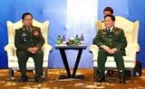 Bộ trưởng Ngô Xuân Lịch gặp song phương Bộ trưởng Quốc phòng Lào
