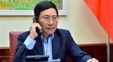 Вице-премьер Министр иностранных дел Фам Бинь Минь провел телефонный разговор с Министром иностранных дел Японии