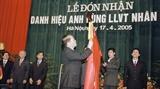 为越南通讯社75周年的光荣历史而骄傲