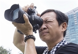 La vie de la rue à travers lobjectif de lartiste-photographe Trân Thê Phong