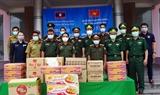 Tặng lương thực thiết bị vật tư y tế cho lực lượng bảo vệ biên giới tỉnh Sê Kông Lào