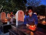 Hơn 60.000 ngọn nến được thắp sáng trên các phần mộ tại 72 nghĩa trang liệt sỹ