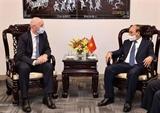 Le chef de lÉtat vietnamien reçoit le président de la FIFA à New York