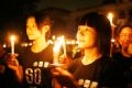 Candles light up confidence in the young people. Photo: Tat Son