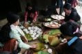 Women of the Mong ethnic group make rice dumplings for Tet Holidays.