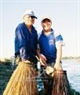 75-year-old Mai Kim Sinh and his 27-year-old son Mai Kim Phuong join the fishing.