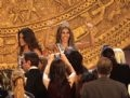 Miss Universe 2008 Dayana Mendoza stands before the throng of cameras and reporters.