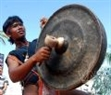 A Ba Na ethnic artist performs the gongs of his group.