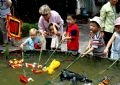 Children playing with water puppets.