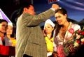 The Chairman of Hoa Binh People's Committee presents the crown to the Miss Muong,  Ho Kieu Anh.