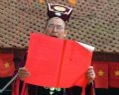 The ritual holder reading the oration in memory of the Trung Sisters' merit.