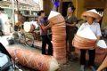Non's of Chuong Village are transported to all parts of the country.