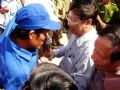 Deputy Prime Minister Pham Gia Khiem greeting the storm survivors setting foot on land.