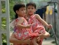 Happiness of Trinh Thi Binh, the twins' mother.