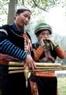 Игра на народном инструменте кхен во время праздника