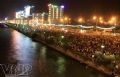 Tens of thousands of people gather along the banks of the Han River to watch the fireworks shows.
