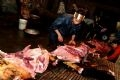 Classifying meat at the slaughter-house of Do Thi Quan's family.