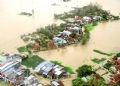 Nhiều khu dân cư phía đông huyện Tuy Phước, Bình Định bị ngập chìm trong nước lũ.
