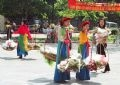 Flower-sellers in traditional costumes.