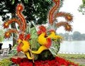 A pair of phoenixes made from fresh flowers.