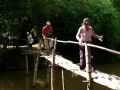 Walking on a bamboo bridge.