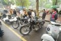 Old vehicles attracted great attention from men.