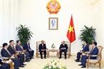 2018年12月10日下午在政府总部,越南政府总理阮春福会见从2018年12月8日至12日访越的老挝司法部部长桑迪翁(Xaysi Santivong)。越通社记者 统一 摄