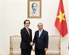 Prime Minister Nguyen Xuan Phuc had a reception for Hiroyuki IshigeChairman and Chief Executive Officer Japan External Trade Organization (JETRO) in Hanoi on July 19 during his working trip to Vietnam. Photo: Lam Khanh/VNA