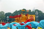 The float carries the symbolic dragon of the Ly Dynasty.