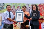 "Beatriz Fernandez, the International Licensing Manager of Guinness World Records presents a Guinness record certificate for ""The Pottery Road along the Red River""."