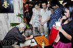 Hình ảnh ông đồ cho chữ, một nét văn hóa Hà Nội xưa cũng được tái hiện tại Lên hoan ẩm thực Hà Thành.