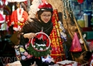 A Hanoi girl buys decorative items for Christmas.