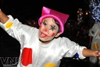 A funny clown performs on the street.