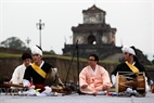 Artists from Dongguk Korean Classical Music Art Company, South Korea, perform at the foot of the wall of Hue Citadel.