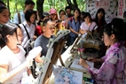 Performing the art of Japanese painting.