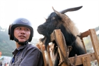 Ly Chau Phinh takes his goat back home after the competition.