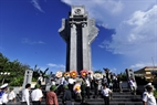 Delegates visit the martyr monument on Truong Sa Lon Island.