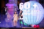 "Earth Hour Ambassador Thanh Lam and her daughter, Thien Thanh, perform together the song ""Tre xanh ru"" to call for people to save energy and protect the environment. Photo: Cong Dat"