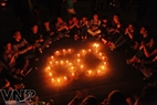 Arranging candles into the number of 60 to call for people to switch off the lights for 60 minutes. Photo: Cong Dat